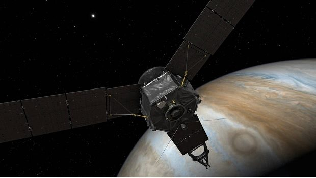 his illustration depicts NASA's Juno spacecraft at Jupiter, with its solar arrays and main antenna pointed toward the distant sun and Earth. Credits: NASA/JPL-Caltech