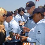 """050802-N-0685S-002 San Diego, Calif. (Aug. 02, 2005) Ð Sailors stationed aboard the newly commissioned guided missile destroyer USS Halsey (DDG 97) homeported in San Diego, receive autographs from Actress Pamela Anderson. Anderson visited the Arleigh Burke-class destroyer to present the USO with a $150,000 check from a variety of entertainment companies. The ship was named after U.S. Naval Academy graduate Fleet Adm. William """"Bull"""" Halsey Jr., who commanded South Pacific Force and South Pacific Area during World War II. Halsey is capable of fighting air, surface and subsurface battles simultaneously and the ship contains a number of offensive and defensive weapons designed to support maritime defense needs well into the 21st century. U.S. Navy Photo by PhotographerÕs Mate 3rd Class Jo A. Wilbourn Sims (RELEASED)"""