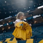 Golden State Warriors Megan Cooper putting shirts out