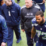 Michael Bennett with Seahawks staff