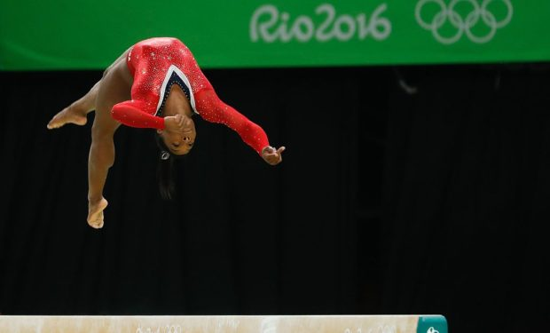 Simone_Biles in the air at the Olympics, barefoot