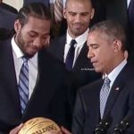 Kawhi_Leonard_presents_ball_to_President_Obama