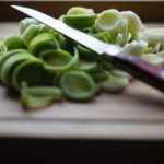 Knife cutting knife on cutting board