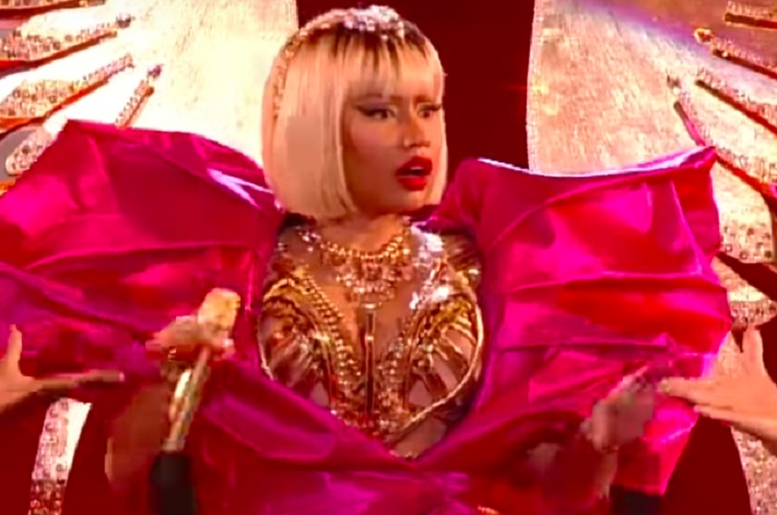 Nicki Minaj In Bold Yellow Swimsuit Shows Jewels and Twerking Gold